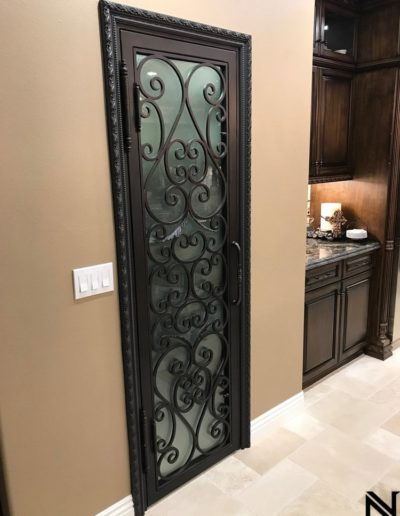 Custom black wine cellar iron doors by Baltic